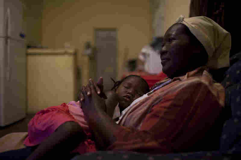 Francisca Guity, who is HIV-postive, sits with her child in her home Jan. 20 in Sambo Creek.