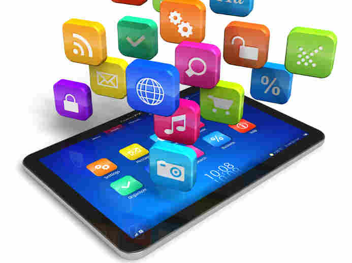 Tablet PC with cloud of colorful apps