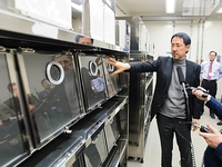 Bird flu researchers use ferrets to study how the virus mutates and spreads. Here virologist Yoshihiro Kawaoka points to the ferret cages in his laboratory at the University of Wisconsin-Madison.