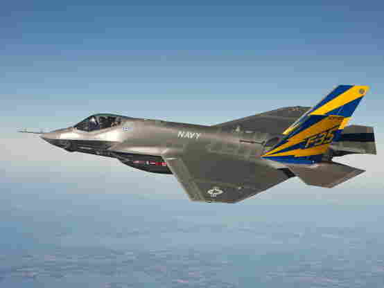 In this image released by the U.S. Navy the U.S. Navy variant of the F-35 Joint Strike Fighter, the F-35C, conducts a test flight over the Chesapeake Bay.