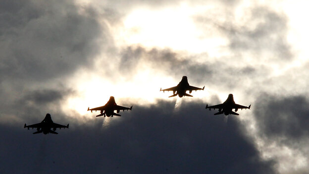 Four F-16s from the 77th Fighter Squadron of Shaw Air Force Base fly over Darlington Raceway before a NASCAR race