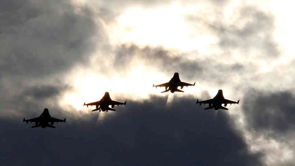 Four F-16s from the 77th Fighter Squadron of Shaw Air Force Base fly over Darlington Raceway before