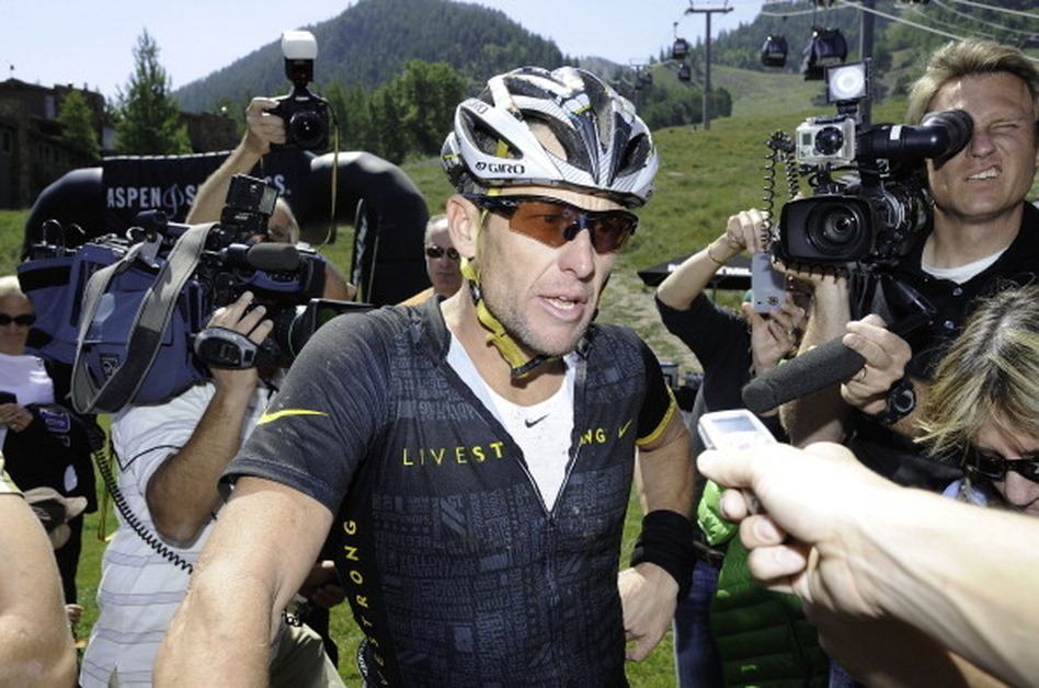 Lance Armstrong finishes the Power of Four Mountain Bike Race on Aspen Mountain on August 25, 2012.