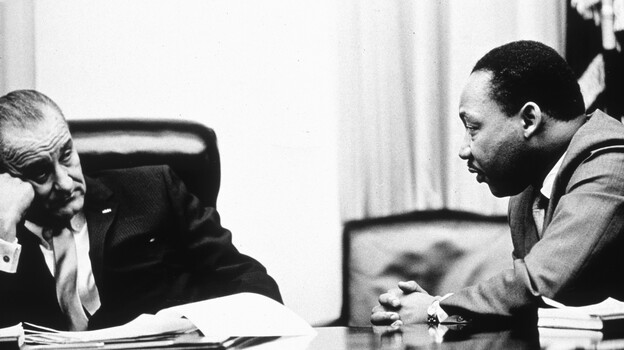 President Lyndon Johnson and civil rights leader Martin Luther King Jr. discuss the Voting Rights Act in 1965. On Wednesday, the Supreme Court hears arguments on whether a key part of the law is still needed nearly a half century after its passage. (Getty Images)