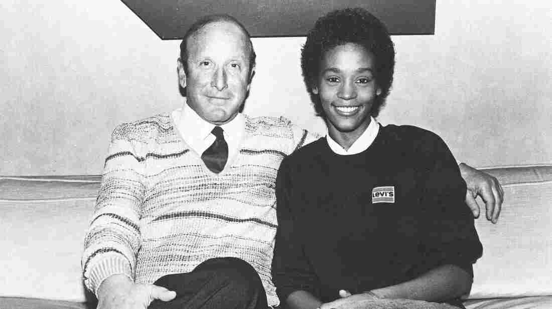 Clive Davis poses with Whitney Houston, then a rising star, shortly after Houston signed a contract with Arista Records in 1983.