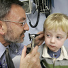 Giancario Gemignani-Hernandez, 2, of Pittsburgh has his ear examined by Dr. Alejandro Hoberman.