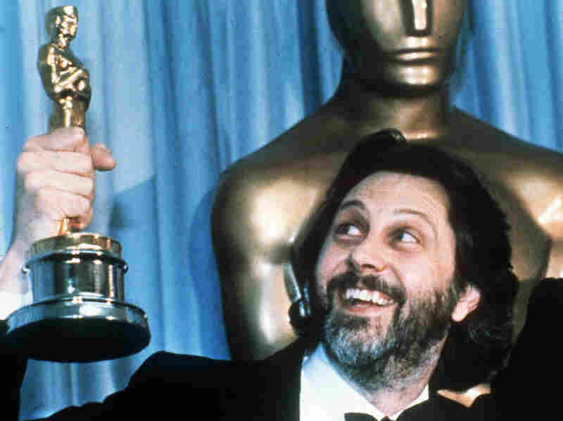 David Putnam, producer of Chariots of Fire, holds up his Oscar after the movie won best picture in 1982.