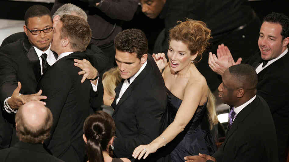The cast of Crash celebrates after its surprise upset of Brokeback Mountain for best picture, at the 78th Academy Awards in 2006.