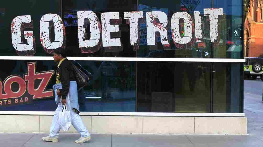 A pedestrian walks in downtown Detroit on Oct. 24, 2012.
