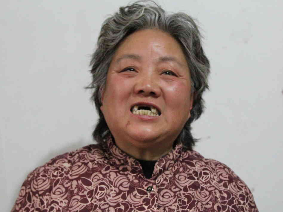 "Shen Lixiu, 58, says she had her front teeth kicked out in a re-education through labor camp. Chinese authorities say they are considering ""reforms"" to a system that is coming under increasing public criticism."