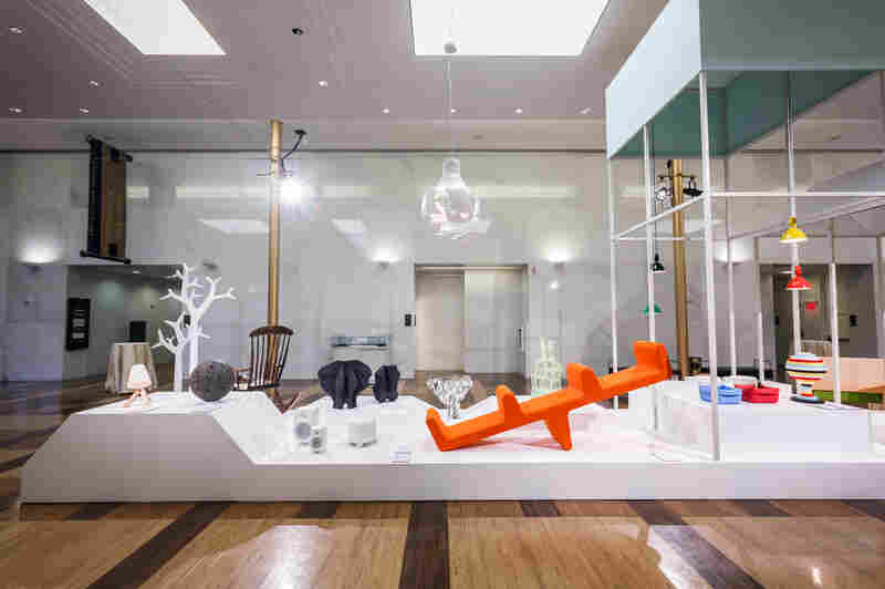 The Nordic design exhibit includes a lava rock, which Jukka Savolainen, director of the Design Museum in Helsinki, says reminds him of a gnome. The collection showcases the region's design roots, which include references to Bauhaus and 20th century modernism.