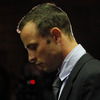 Oscar Pistorius, standing at the dock Friday in a Pretoria courtroom.