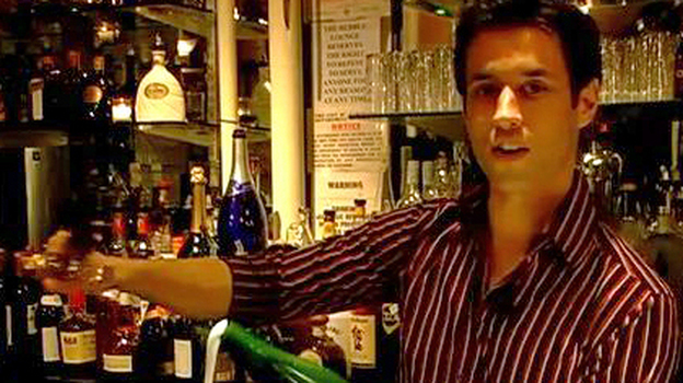 Brice from the Bubble Lounge in New York City demonstrates how to saber a bottle of champagne. (About.com)
