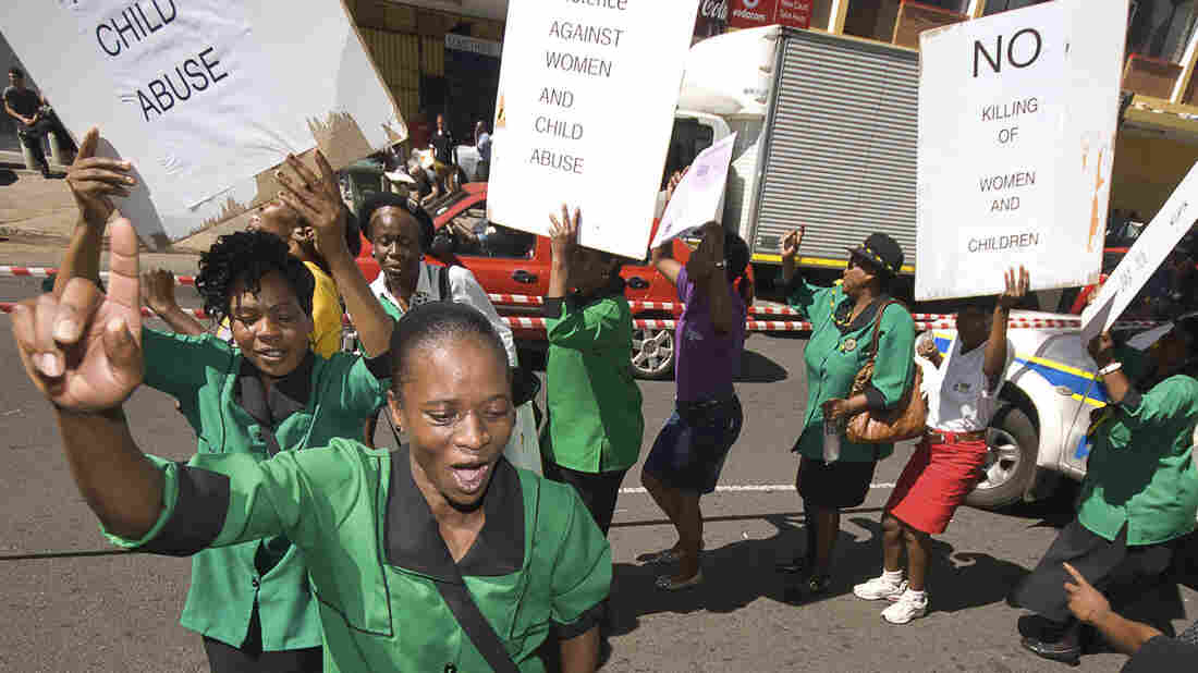 A women's group protests Tuesday outside the courthouse in Pretoria, Sout
