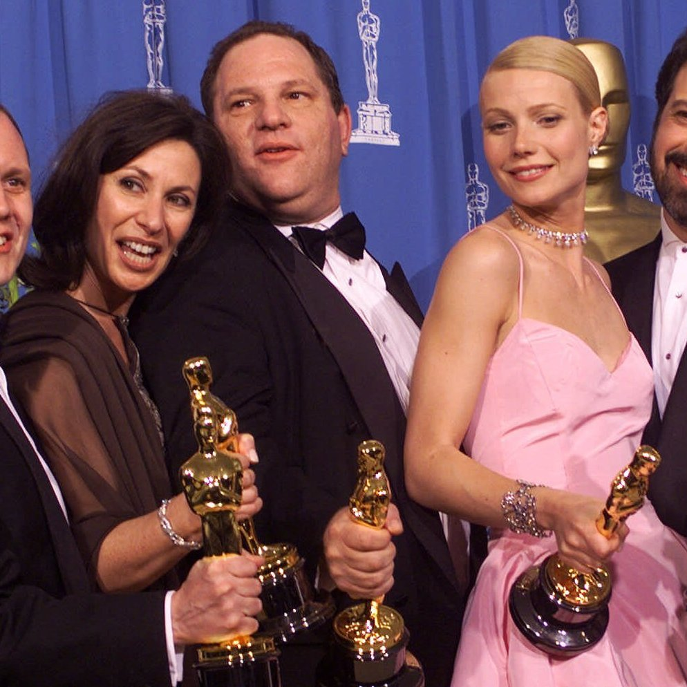 Producers and cast celebrate after winning best picture for Shakespeare in Love during the 71st Annual Academy Awards.