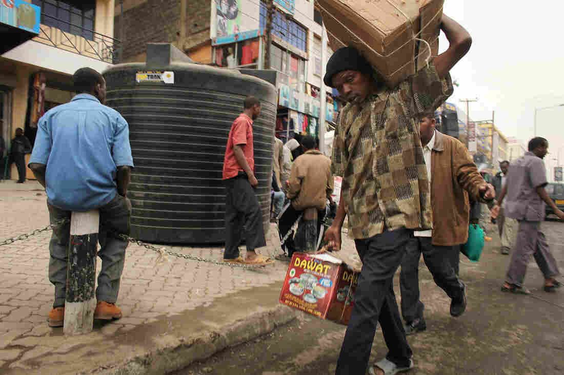 People walk down a market street in Eastleigh, a predominantly Muslim Somali neighborhood in Nairobi, Kenya, in 2009. The nei