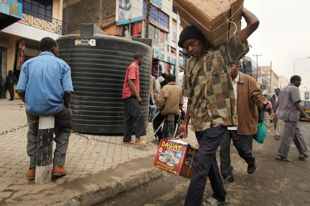 People walk down a market street in Eastleigh, a predominantly Muslim Somali neighborhood in Nairobi, Kenya, in 2009. The neighborhood has come under scrutiny as the U.S. cracks down on terrorism financing.