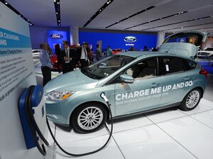 A Ford Focus electric concept car with a home