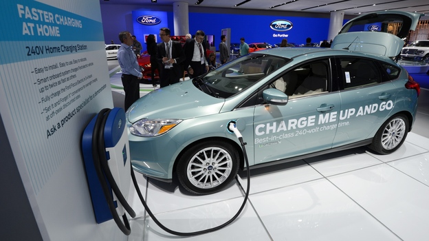 A Ford Focus electric concept car with a home charging unit on display at the 2013 North American International Auto Show in Detroit, Mich., in January. (AFP/Getty Images)