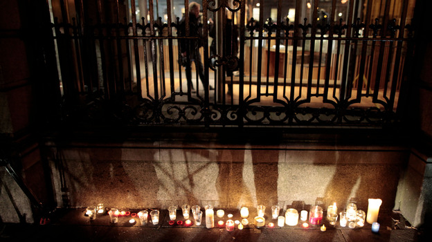 Candles burn outside grounds of Leinster House, placed by relatives of victims of the Catholic-run work houses known as the Magdalene Laundries in Dublin, Ireland, on Feb. 19. (AP)