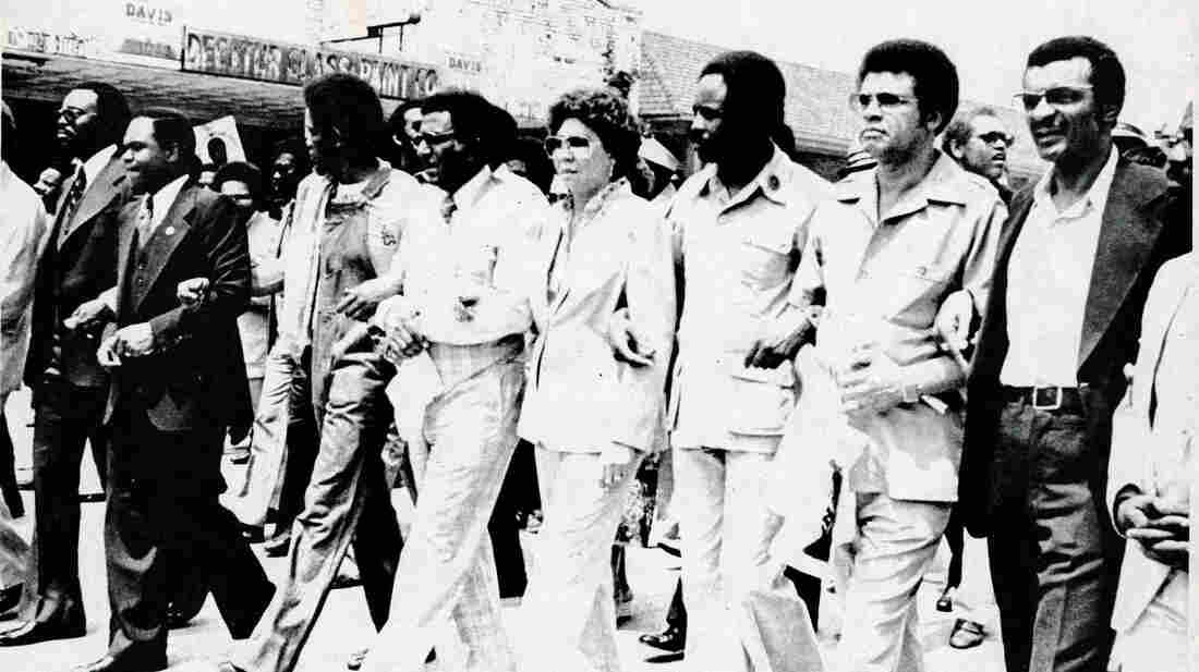 """An undated photo from the exhibit shows Southern Christian Leadership Conference officials leading demonstrators in a march """"against fear and injustice"""" in Decatur, Ga."""