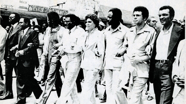 """An undated photo from the exhibit shows Southern Christian Leadership Conference officials leading demonstrators in a march """"against fear and injustice"""" in Decatur, Ga. (SCLC records, MARBL, Emory University)"""