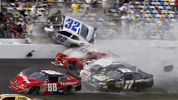 Kyle Larson (32) goes into the catch fence at the conclusion of the NASCAR Nation