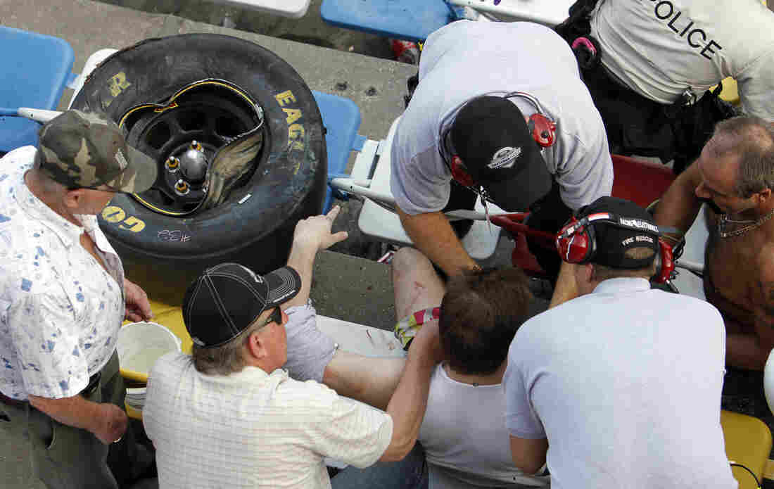 A tire from Kyle Larson's car flew into the stands during a crash at the conclusion of the NASCAR Nationwide Series race Saturday.