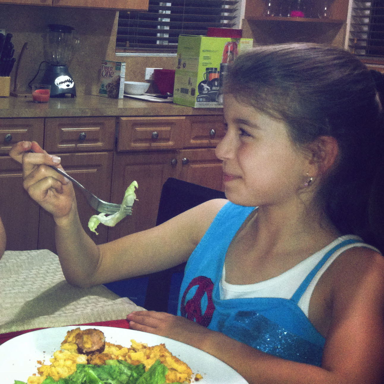 Vanessa Benavides, a Cuban-American single mom, and her 7-year-old daughter, Emily, eat dinner together at their home in Miami.