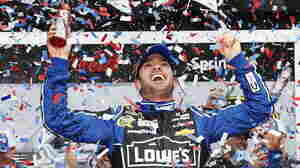 Jimmie Johnson celebrates in victory lane after winning the NASCAR Sprint Cup Series Daytona 500 at Daytona International Speedway on Sunday in Daytona Beach, Fla.