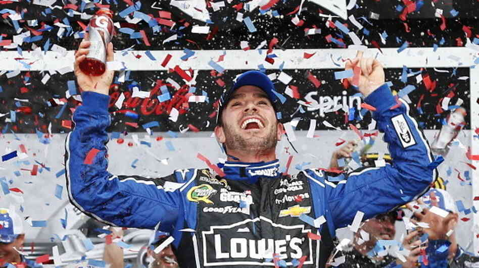 Jimmie Johnson celebrates in victory lane after winning the NASCAR Sprint Cup Series Daytona 500 at Daytona International Speedway