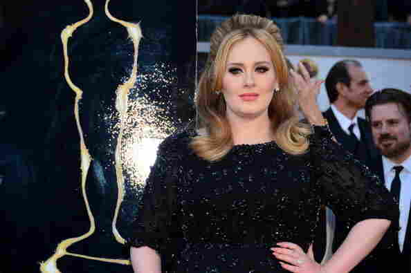 "Singer Adele wins the Oscar award for best original song for her 007 song, ""Skyfall."""