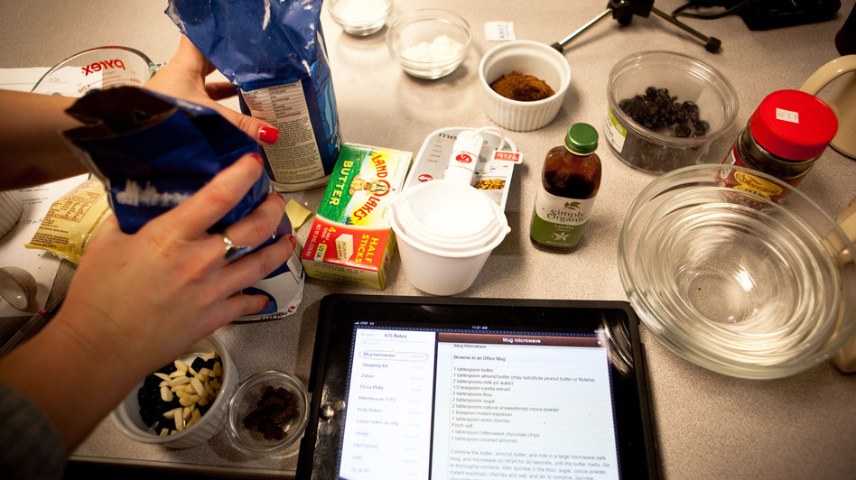Morning Edition producer Rachel Ward preps the ingredients for a microwave creation. (NPR)