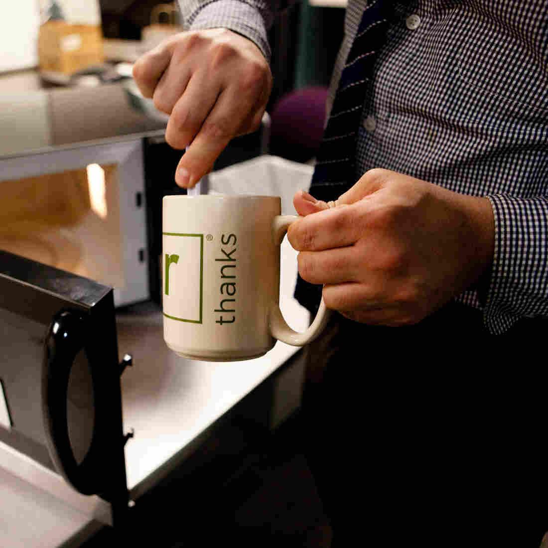 Washington Post Food and Travel Editor Joe Yonan whips up some macaroni and cheese in an NPR mug.