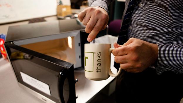 Washington Post Food and Travel Editor Joe Yonan whips up some macaroni and cheese in an NPR mug. (NPR)