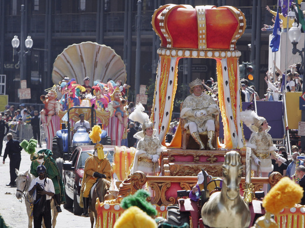 Paul C.P. McIlhenny reigns as Rex as he arrives at Canal Street during Mardi Gras celebrations in New Orleans on Feb. 28, 2006, six months after Hurricane Katrina devastated the city. McIlhenny, the CEO and chairman of the company that makes Tabasco sauce, died Saturday in New Orleans. He was 68.