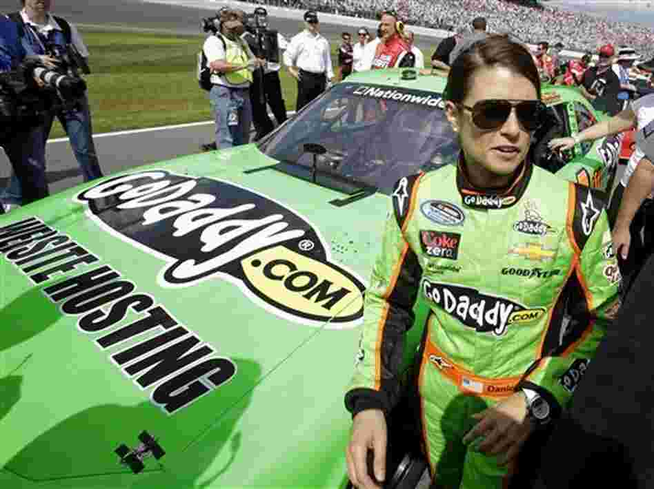 Danica Patrick stands by her car before the start of the NASCAR Nationwide Series auto race at Daytona International Speedway on Saturday in Daytona Beach, Fla.