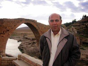 Esho Joseph stands in front of the Nemo Delale bridge in Zakho, Iraq. Joseph, a former translator, grew up speaking Aramaic.