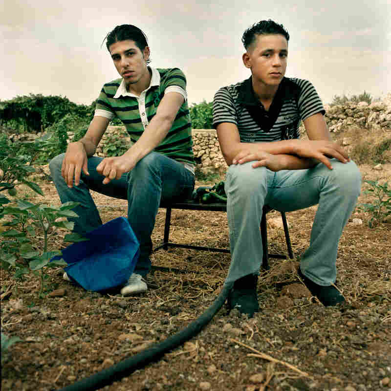 Taha (right), photographed in 2010, was planning to start studying at Bethlehem University next year, but most of the young who graduate are unemployed.