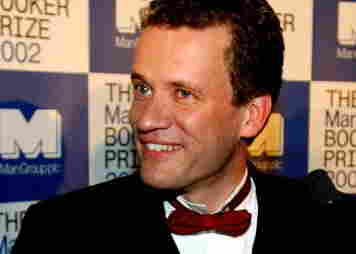 Canadian author Yann Martel smiles for photographers after winning the Man Booker Prize.