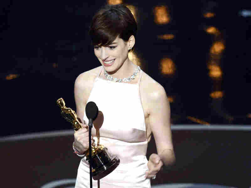 Anne Hathaway accepts the Oscar for best supporting actress in Les Miserables.