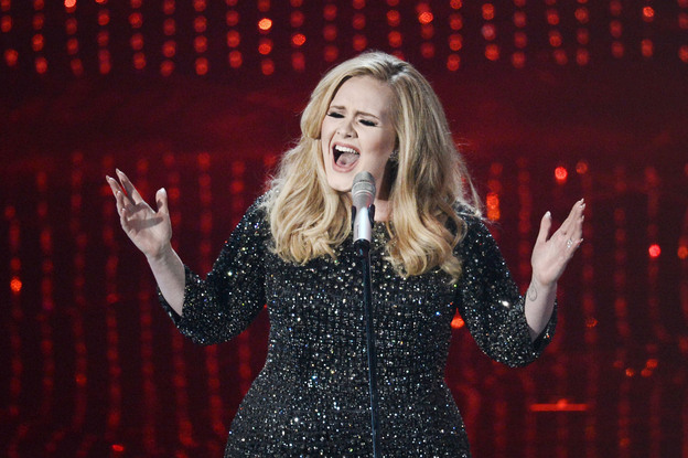"Adele performs the theme song to ""Skyfall."" (Getty Images)"