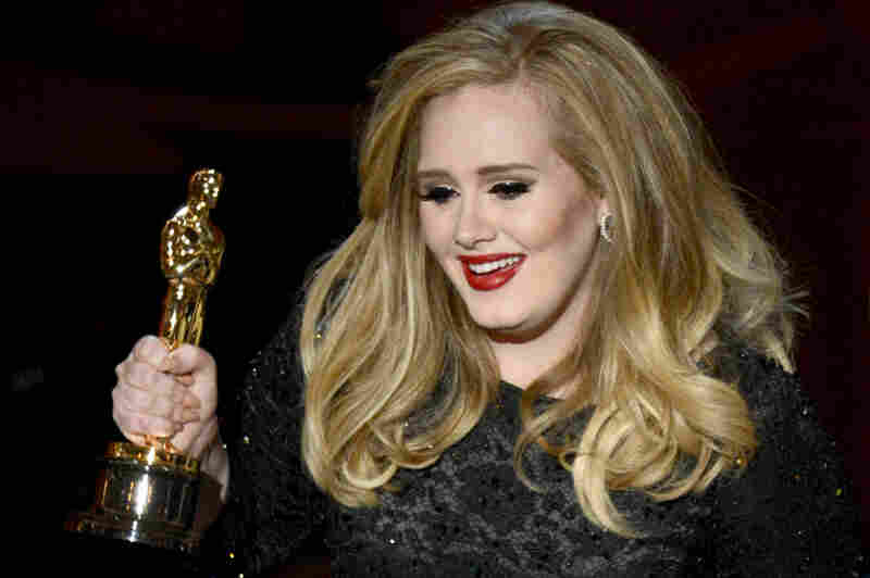 "Adele accepts the Oscar for best original song — the theme song in ""Skyfal"