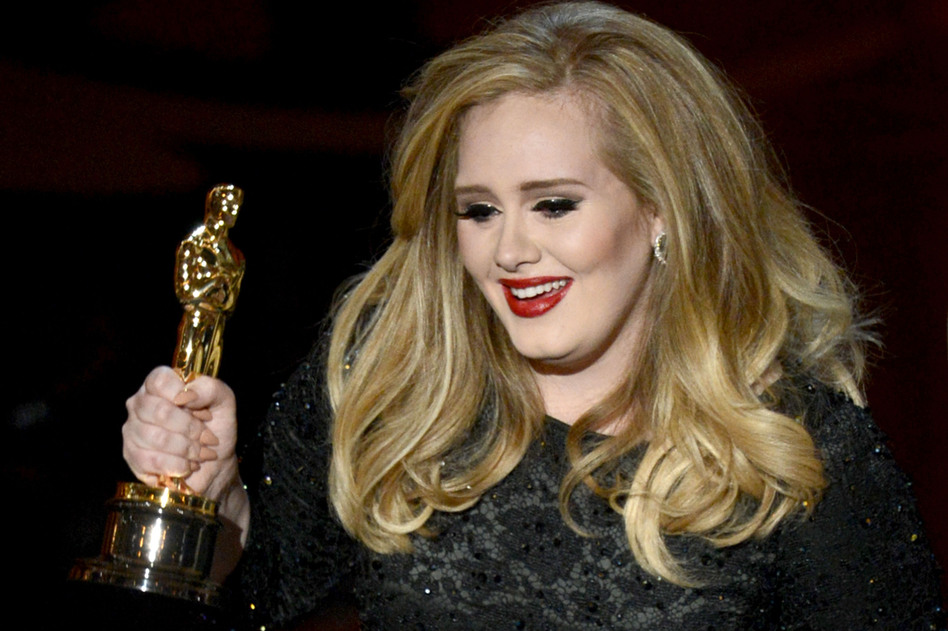 "Adele accepts the Oscar for best original song — the theme song in ""Skyfall."" (Getty Images)"