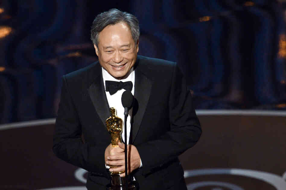 "Director Ang Lee accepts the best director award for ""Life of Pi."""