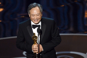 """Director Ang Lee accepts the best director award for """"Life of Pi."""""""