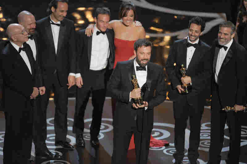 "Ben Affleck accepts the Oscar for best picture for ""Argo."""