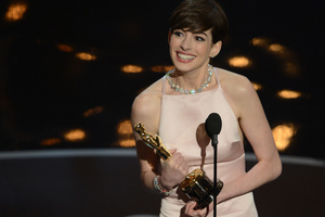 Anne Hathaway accepts the Oscar for best supporting actress for her role in