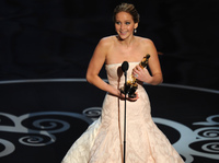 Jennifer Lawrence accepts the Oscar for best actress in <em>Silver Linings Playbook.</em>
