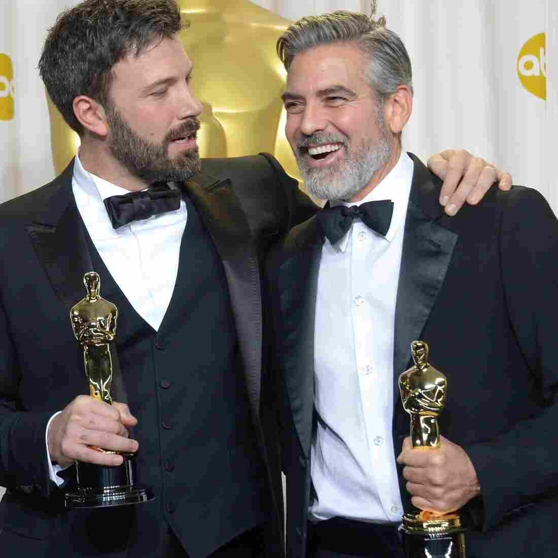 Ben Affleck (center), George Clooney (right) and Grant Heslov celebrate in the press room after winning the Oscar for best picture for Argo.
